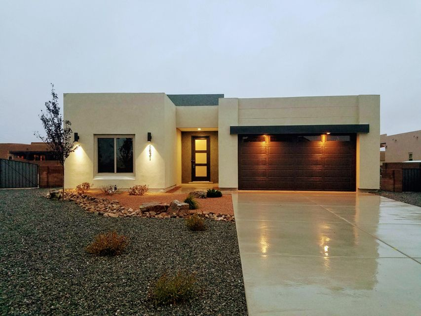 Brand new home in the beautiful Volcano Cliffs community! This home features 2,211 sq. ft. with 3 beds and 2.5 baths. The open floor plan with 12' ceilings above living/dining/kitchen and 10' ceilings above master bedroom/bathroom feels spacious and luxurious. Living area contains a custom gas fireplace and not one, but two large, three-panel doors that slide completely into the wall.  This maximizes your ability to live outdoors or entertain a crowd on the beautiful patio/courtyard with stunning views of the sunset! Granite in kitchen/baths/laundry, upgraded stainless steel appliances, custom cabinets, ceramic wood-look tile throughout, freestanding tub, TerraNeo accents, etc. Floor throughout is flat and accessible.  Beautiful home in a beautiful community!