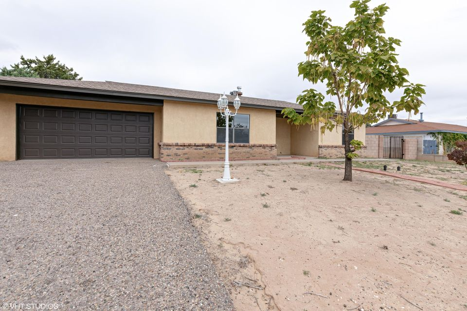 Don't Miss This Wonderful Home On A Cul De Sac. Huge private backyard! Freshly painted! Laminate flooring through-out! New stainless whirlpool appliances! Open floorplan! Kitchen includes pantry! Conveniently in Rio Rancho. Close to trails, shopping and schools! 2 car garage!