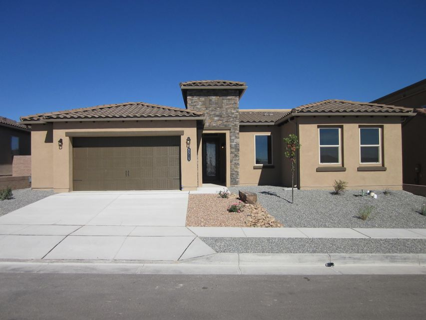 Brand new Multi-Generational home with a separate living area and entrance  . Separate bathroom, bedroom and Living area. WOWThe Multi-Gen living area has a Kitchen sink with Microwave and refrigerator hookup.   Also included is a Stacking washer and Dryer tucked away in the walk in closet. The main portion of the home has a spacious Master bedroom with large master bath and Huge walk in closet that opens to laundry room.Family room and  island kitchen have open feeling with 10' ceilings. Great for family time area.  All this and Green build New Mexico energy savings. Tank less hot water with recirculating timer and pump for instant unlimited hot water. Need efficiency for up to Three generations in one HOUSE! Here it is. Home is completed with a look at the mountains from dining a