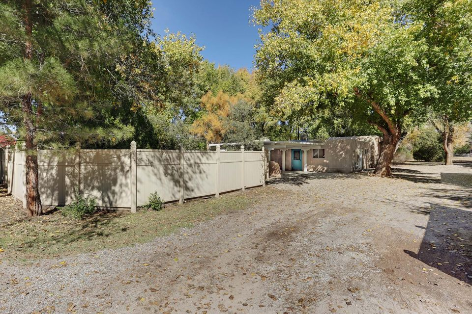 INCREDIBLE Setting on Almost 2 Acres Shaded By Towering Cottonwoods on One of Corrales Most Beautiful Streets ** Over 3600 Square Feet of SW Style Built by Cleff **  The Main House has  2530 Sq Ft with 4 Bedrooms Plus an Office and 3 Baths ** Brick Floors Plus Some Newly Carpeted Areas ** Infloor Radiant and Baseboard Radiant Combo, Gas Fired, and 2 New Evap Coolers ** Kiva Fireplace, Some Wood Beamed Ceilings, Raised Panel Wood Doors ** 2 Car Carport ** New Dishwasher and Disposal ** Guest House/Studio is 1285 Sq ft with 2 Rooms, Two Baths + Spacious Living Area with Access to a Private Patio  ** , Brick Floors, Kiva Fireplace, Refrigerated Air, Gas Forced Air Heat, Some Wood and Beamed Ceilings  and a 2 Car Carport that Has Been Re Roofed **