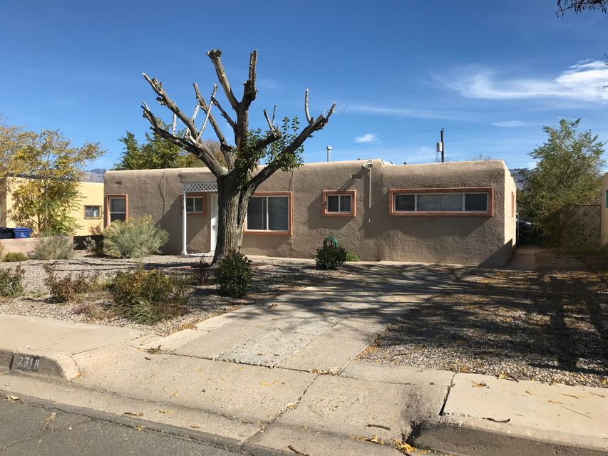 Starter home with large ample front and back yard. back yard with acces.Thsi home is in a nice quiet neighborhood in Uptown Albuquerque. This home is close to Coronado Mall, schools, shopping, dinning entraining, you name it.