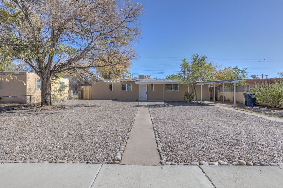 This three bedroom one and a half bath Home is located in the heart of Albuquerque. This Home has been updated for you to start your book of life. This Home has new stucco, windows, cooling, heating, roof & updated electric panel. The Home is located on a large lot for you to enjoy your outside toys and tools. Please stop by and start the life of Home ownership.