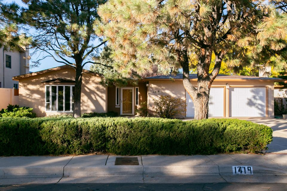 Mid Century Single Story, mature trees on a large low maintenance lot, located in high demand Altura Park Neighborhood. Close to UNM, Nob Hill, KAFB, Sandia Labs, hospitals, downtown, restaurants, & shopping. THREE Living areas, 4 bedrooms, 3 baths.  Kitchen is freshly painted with new refrigerator, microwave and dishwasher. Skylights & windows provide natural light.  Many upgrades throughout. Private enclosed courtyard, ideal for entertaining year round, includes hot tub. Custom home features separate second master bedroom and living room which could be perfect for in-law qtrs. or multi-generational family living. Need a game room? 3rd living area is large & space for pool table. Over sized 2 car garage. New roof October 2018. OPEN HOUSE 12/16, 1 - 3pm