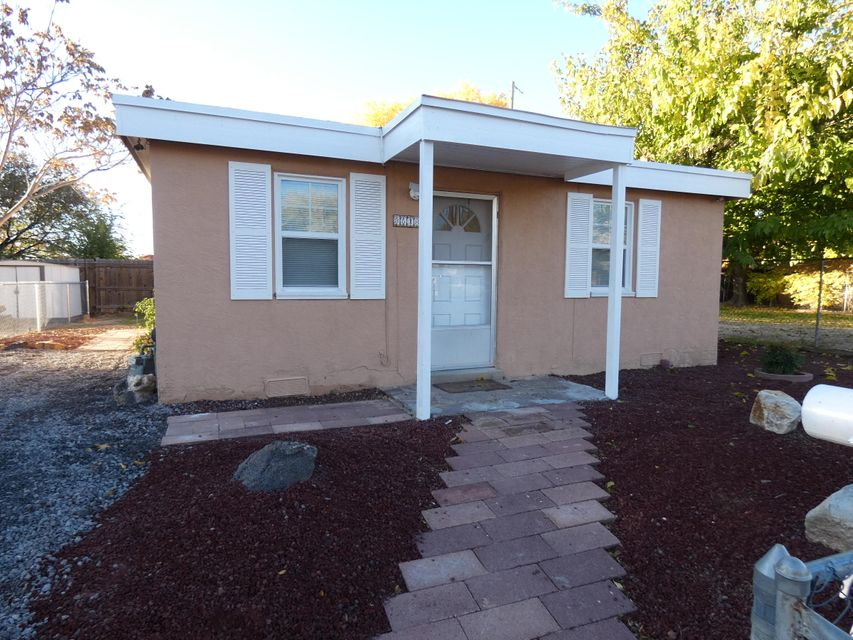 Super cute one bedroom home, very well maintained.  New roof, new fascia, new cabinet doors in kitchen, freshly painted inside and out, built-in table for four, laundry room with washer and dryer, frig included, security cameras, refrigerated air, vinyl windows, fully fenced yard.