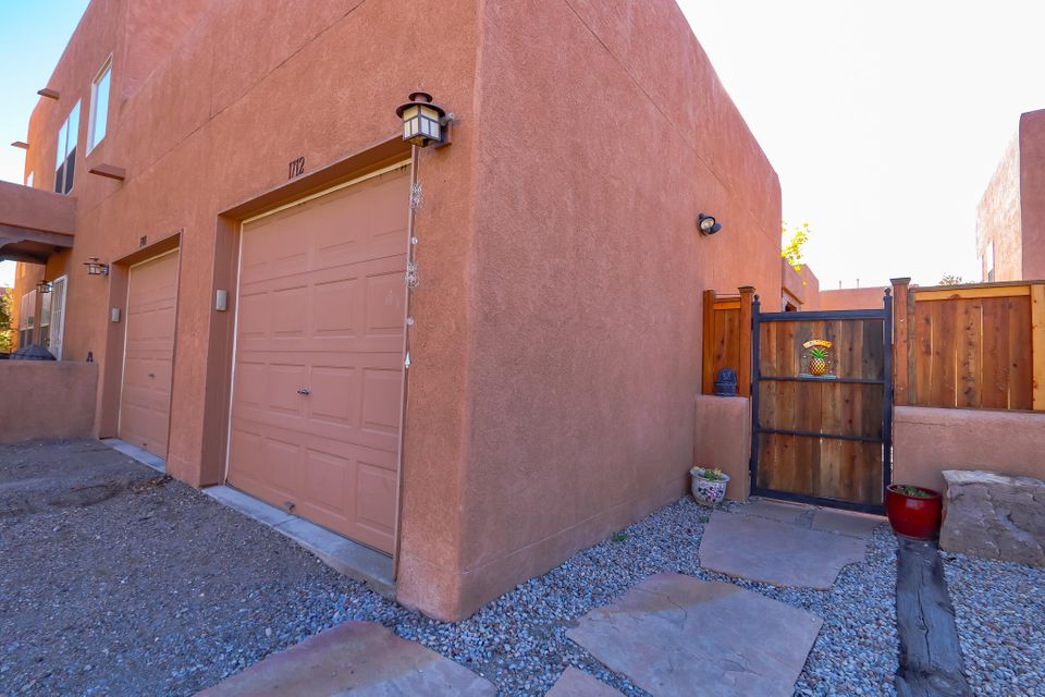 You will feel at home in this charming townhome located in the lovely, private Los Jardines neighborhood.  This North Valley community is filled with rose bushes, fruit trees and greenery, complete with walking trails and a playground. This beautiful home has an open floor plan, updated flooring throughout, stainless steel appliances and a relaxing private patio. Convenient location near Old Town, Downtown and minutes from the interstate.  Make this sweet home yours today!