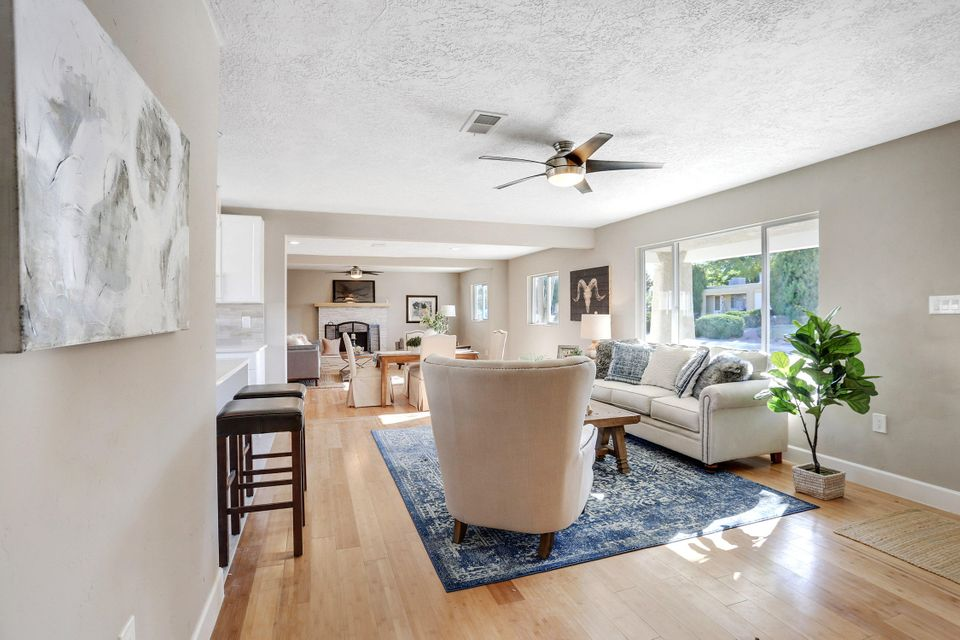 **Open House Friday 11/16 2:00 to 5:00 & Saturday 11/17 12:00 to 4:00** This fully updated home in the heart of ABQ Uptown is ready for a new owner. The home features New Kitchen, Bathrooms, Large Master Bedroom with a walk in Closet all this plus a new AC/Heating system with new duck work. Home has three bedrooms plus a office. Great size laundry room. Located on a corner lot with big Trees. Come by and see this great house today!!