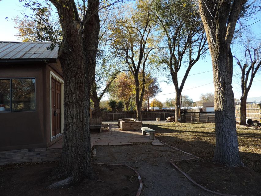 True North valley home, on approx half acre, beautiful treed lot,  next to irrigation ditch on Campbell Rd near river. Make this house into your dream home!