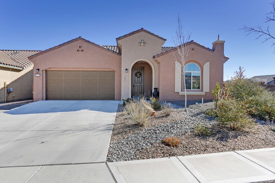Why wait to build a home when this beautiful home is MOVE IN READY. It has the window treatments, landscaping and ready for new owners. Handicap accessible and all on one level. The kitchen is open to the MLA and the dining room. The master bath has a large shower with a seat. Enjoy the lights of Albuquerque while you sit by the warm and cozy gas log fireplace. This home has many extras and is READY FOR YOU. Home is on a corner lot with a  park across the street with putting greens. CLUB HOUSE with POOL and many amenities.  Call to see it TODAY!!!