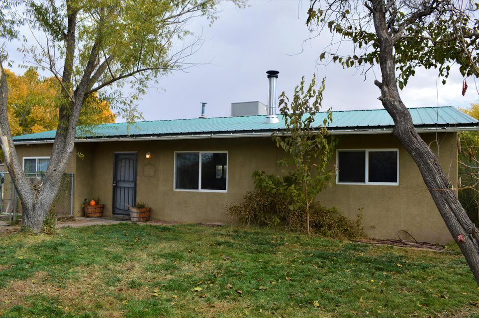 Space and convenience in the heart of Los Lunas! This 1707 sq ft home with 3 bedrooms, 2 baths sits on a half an acre with a large shop and 4 car carport. Backyard access and tons of space to park all of your toys. Home has updates throughout, spacious kitchen and master bedroom and bath. Updated home with refrigerated air!