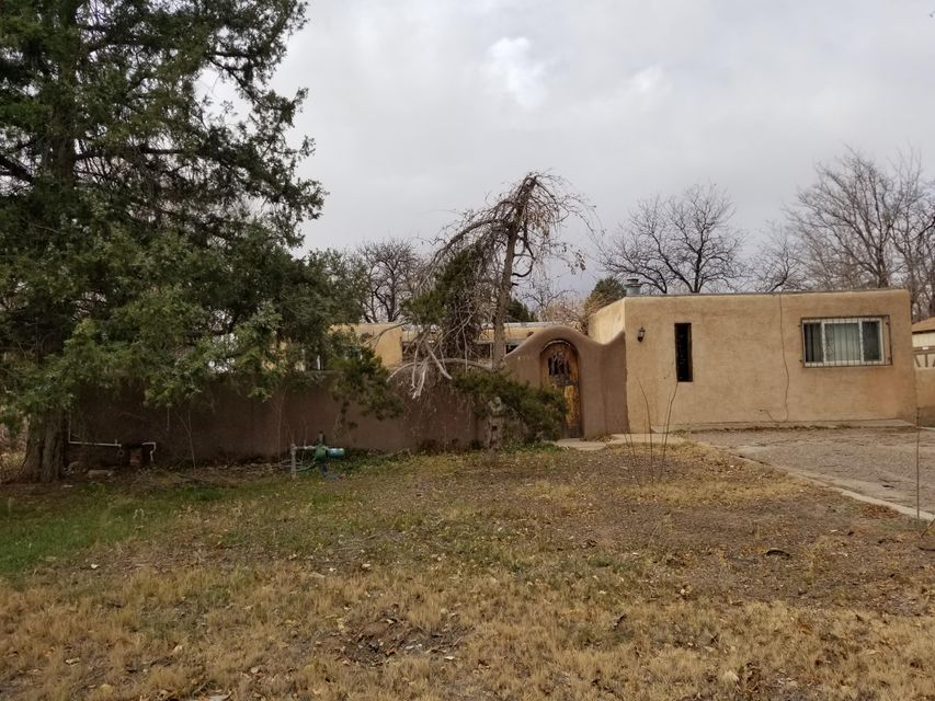 3 bedroom, 2 bath a possible 4th bedroom or 2 living areas. This cozy home is on a huge lot.  Newer roof, updated windows all appliances convey wonderful private courtyard, fruit trees and a shed. Needs updating price reflects condition!! Must See