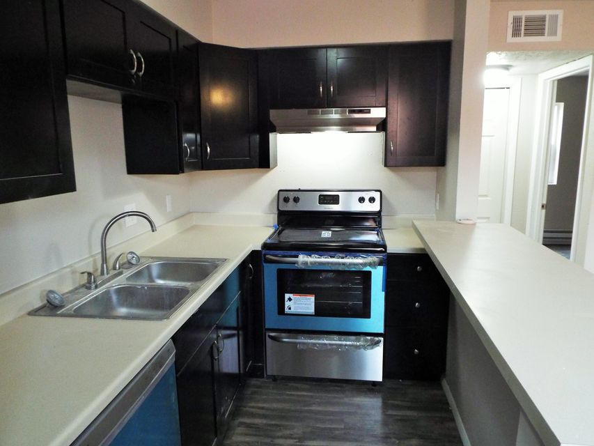 Beautifully remodeled condo in the NE Heights.  Backs to a nice park!