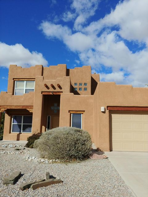 Beautiful Pueblo style 2 story home in the growing and developing Los Lunas Community. This home offers lots of room for entertaining, a captivating back yard, updated kitchen, stainless steel appliances, refrigerated air conditioning and the master bedroom is conveniently located down stairs. You will be close to shopping, schools entertainment and the new Facebook Data Center.