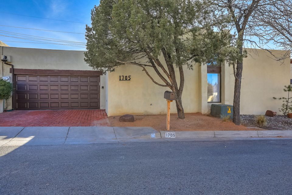 LOCATION and VALUE near UNM and close freeway (I-40) access! Are you a student at UNM or work at/near the University or someone wanting to be centrally located?Looking for a possible rental investment?  You have found it! This recently updated 2 bedroom (possibly 3), 2 full bath home is beautifully maintained and includes new carpet, an entirely new master bath and special features galore!  The back yard space is perfect for children and/or pets.  Low maintenance and single story, this special property is move in ready. The great open floor plan includes two possible living spaces (or a bonus space for dining or another bedroom). A full two car garage with some extra space for storage and an entry gate and security system are additional EXTRAS! Schedule your showing today!