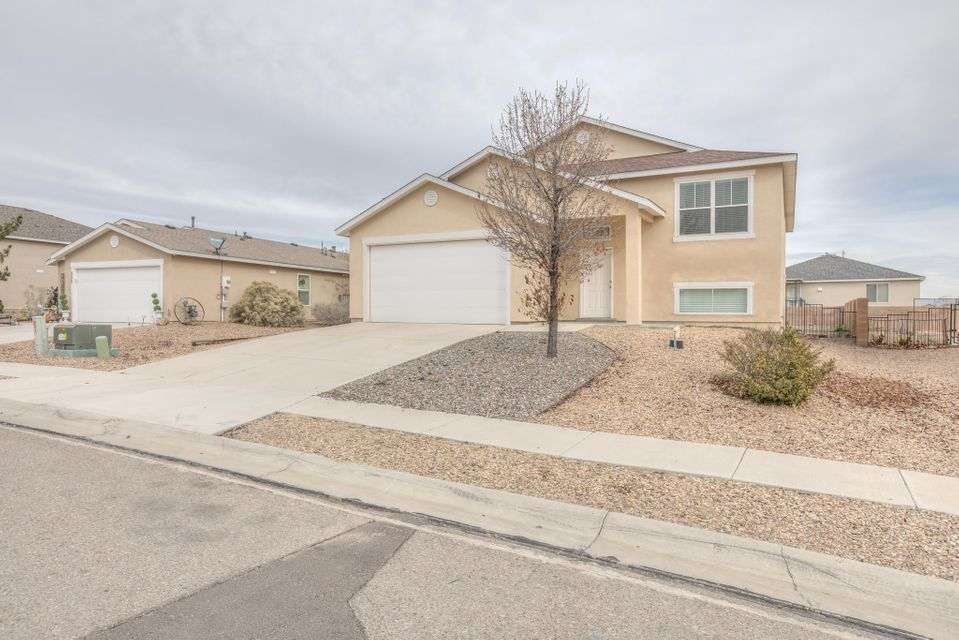 This five bedroom, three bathroom Home is located  in Los Lunas near Facebook and Walmart for a quick commute to work. This Home is also near I 25 for a quick 20 minute commute to Albuquerque. The Home also has two large living rooms for entertaining or private time at Home. The open kitchen has plenty of storage space for all of your cooking projects or just microwaving a hot plate. The big back yard has a balcony with stairs that will transfer you to the covered patio for barbecues or yard work. Los Lunas is an up and coming Village with plenty of work and room for play so come live a lifestyle in Huning Ranch.