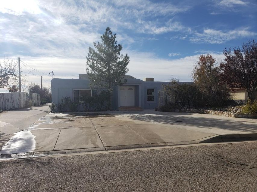 Beautifully renovated home in Rio Rancho just off Golf Course rd. on Sue Circle. 3 bedroom 1 3/4 bath on large 1/2 acre lot. House has a new roof, new stucco, new windows, new septic tank, inside has been freshly painted through-out, and new carpet. All new switches outlets, light fixtures and ceiling fans. Rooms have base board heating with individual thermostats for individual comfort levels and energy efficiency. Kitchen is completely new, tile, cabinets, counter tops, and double basin sink with new faucet and disposal. New appliances included are above range microwave, range, and dishwasher. House features a nice living/dining area and a large den, laundry room with new water heater, master bedroom and 2nd bed room feature walk in closets with adjustable shelving.