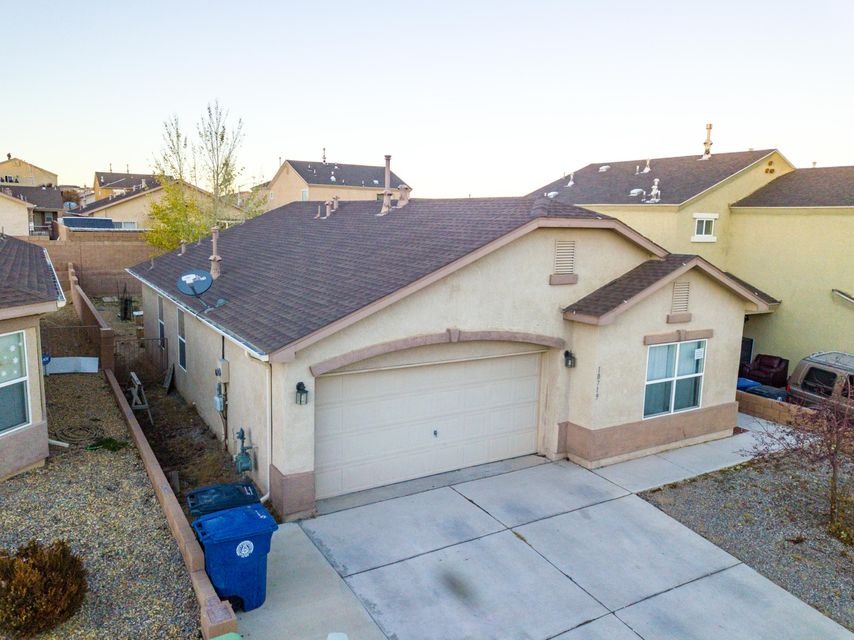 Lovely 3 bedroom with custom lighting, paint, laminate flooring, vaulted ceilings in living room. Move in ready home with large backyard. Perfect start up home for anyone. Refrigerated air a big plus.No Home Owners Association and NO PID.