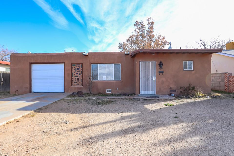 What a find! A fantastic home with three bedrooms, TWO bathrooms, TWO living areas, a formal eating space, custom wood fireplace, laundry room/bonus space, large yard, updated windows and so much more! Move in ready!