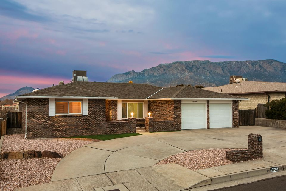 Looking for a SPECTACULAR view of the Sandia Mountains?  Looking for a home that backs up to the Bear Canyon open space?  Looking for a one story home in the far northeast heights?  We have the house for you!  A delightfully updated home with gleaming wood floors, modernized kitchen with new appliances, cabinets and countertops, wood burning fireplace, lots of light with three bedrooms and two baths.   New HVAC system with refrigerated air, new water heater, new paint and a view to die for! Roomy backyard with covered porch and lots of space and a gate to access the open space.  A great location close to schools, grocery shopping, restaurants and a short drive to miles of hiking and biking trails at the base of the Sandias.