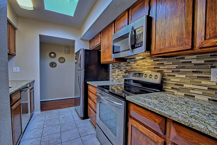 This updated kitchen has it all; gleaming tile, granite countertops and a skylight