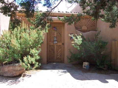 Welcome to your own private Placitas Paradise! Partial (mostly) ADOBE construction w/ Hurd & Pella wood windows & doors.  Enter through the enclosed courtyard. Once inside, the unique floor plan will envelope you in comfort and draw  your eyes to the stunning VIEWS of the Sandias.   Boasting 4 kiva fireplaces, beam/tongue & groove ceilings & a nice separation of bedroom quarters, the master suite has an attached studio or project room with a meditation loft and gorgeous views to inspire all of your creativity.  Brick floors throughout are easy care and radiant heat will warm your bones in the winter months.  Enjoy the many covered patios and SALT WATER POOL for relaxation and taking in the Placitas Vistas & the Land of Enchantment.  Welcome Home!