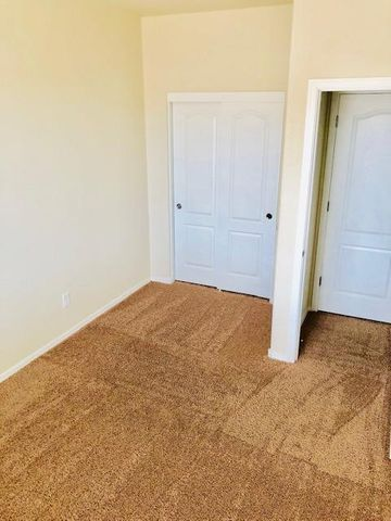 Still like new! 3 bed 2 bath in beautiful Saltillo located in NW Albuquerque. Ajo model with over $10k in upgrades, granite tops, beautiful cabinets, covered patio out back, just a few of the many features in this single level home. clean and move in ready! Owner finance considered.