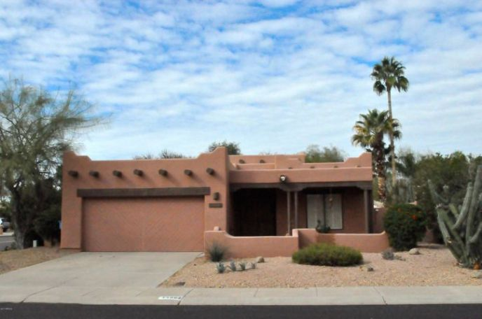 A true Santa F set in afabulous location. Such charming curb appeal with all the true southwest touches.