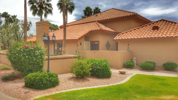 Upgraded Single-Story 2 bedroom 2 bath End Unit with rare 2 car garage!