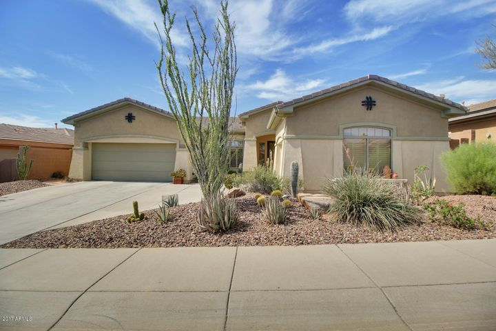 HOME SITS ON ELEVATED LOT. GARAGES: 2 CAR & 1 CAR W/ SERVICE DOOR TO BACKYARD, BUILT-IN CABINETS, & 2 WORK BENCHES!