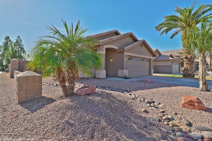 Front picture of home on a corner Lot | The Property backs up to huge park