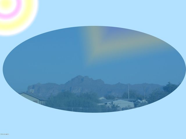 VIEW OF SUPERSTITION MOUNTAINS FROM FRONT YARD WITH VIGNETTE & SPECIAL EFFECT.