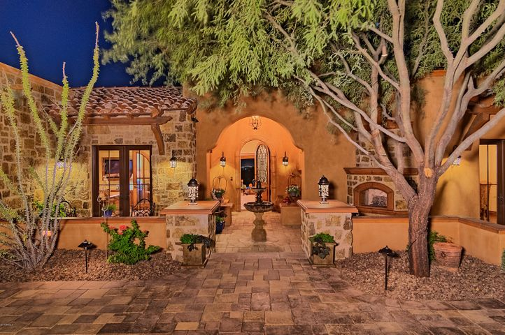 Warm and inviting entrance, beautifully designed with fountain, sitting areas and gas fireplace.
