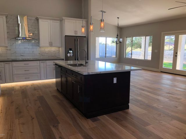 Great room - Pictured from eat in kitchen. View of kitchen dining area, and living area.