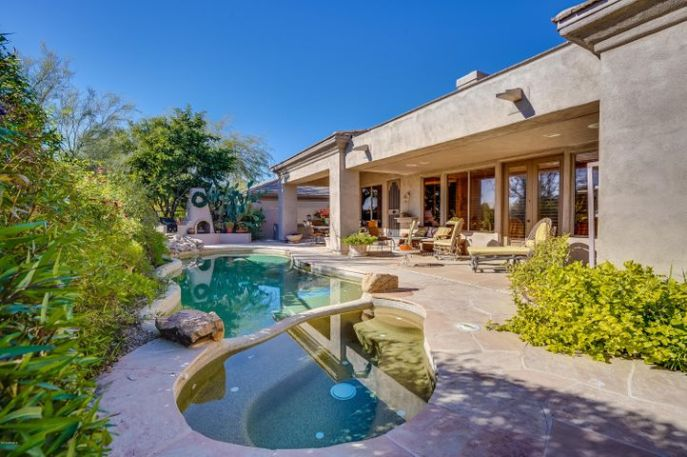 The Back Yard that has it all : Pool/Spa, Gas BBQ and Gas Firepit; ample covered and open Lounging and Dining spaces---even a Custom built in Serving Bar (great for outdoor Dinners, Parties.....).