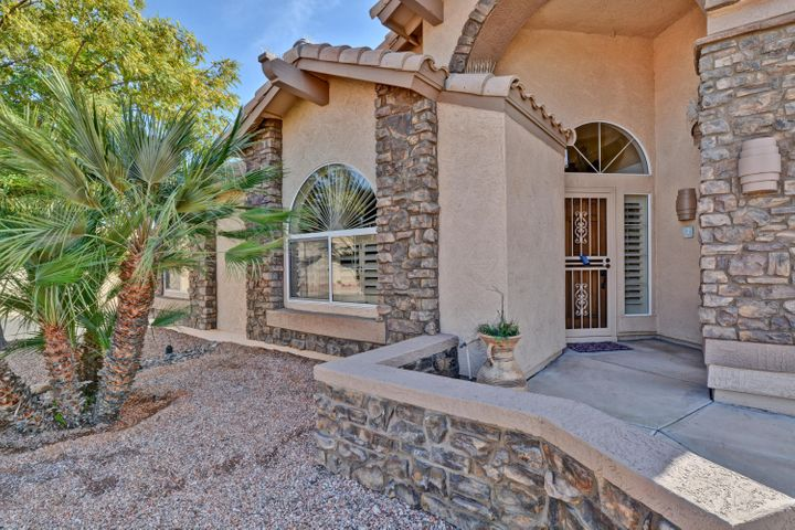 Curb appeal with stone trim and more!