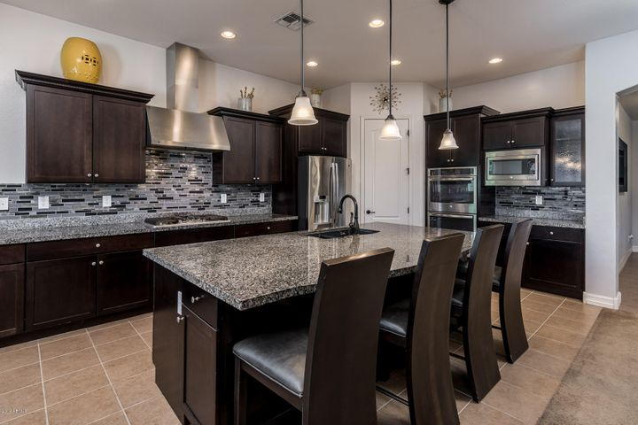 SS appliances double ovens and gas cooktop