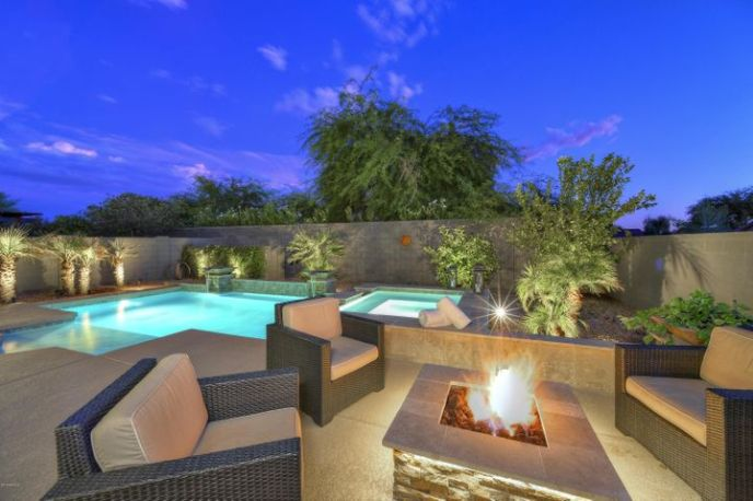 Private South facing resort style back yard. Heated pool,spa,gas fire pit,built-in BBQ.