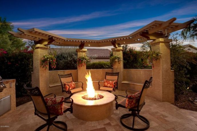 ARBOR WITH GAS FIREPIT & TRAVERTINE PAVERS(seen in photo), BUILT-IN BBQ, & ZEN WATER FEATURE