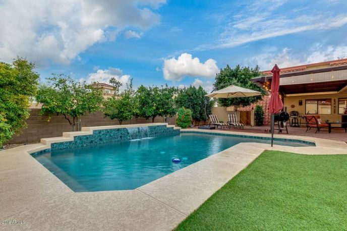Beautifully Updated Pool with Water Feature