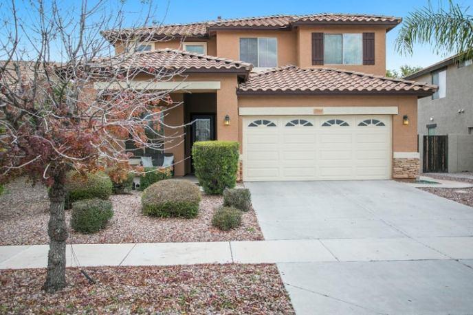 Front view, Desert landscaping, 2 car garage.
