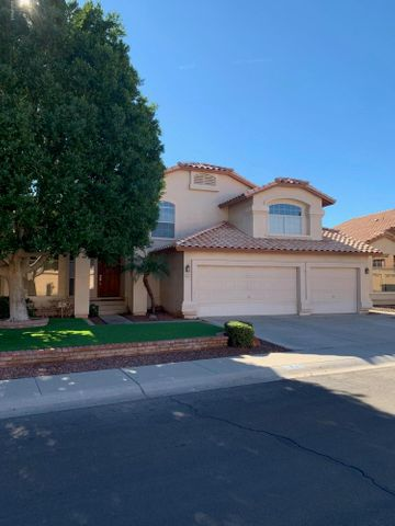 5 beds, 3 baths, 3 car garage in desirable LAKE COMMUNITY of Pecos Ranch.