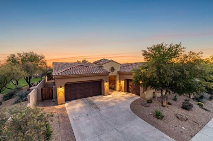 Nestled on a secluded oversized lot with only one neighbor and backing to a green space is a rare find for this neighborhood.