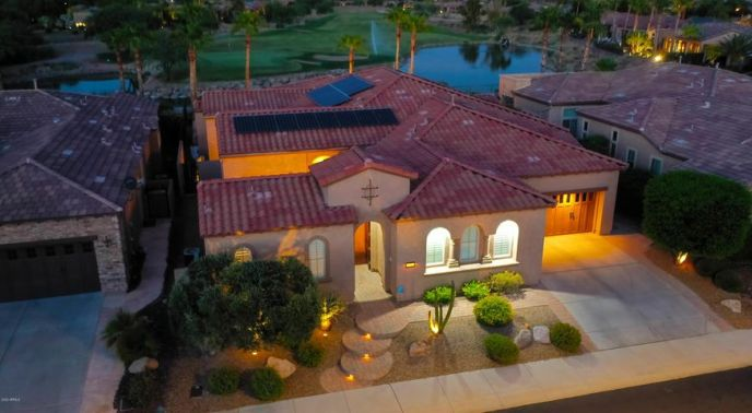 Front of home situated on 14th green in Trilogy at Vistancia