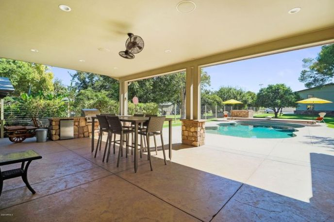 COVERED PATIO VIEW TO POOL AREA AND R.V. GARAGE