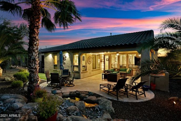 BUILT-IN GAS FIREPLACE, BUILT-IN BBQ, STUNNING MULTI-TIER WATERFALL, HUGE TRAVERTINE PATIO, PUTTING GREEN