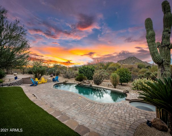 Enjoy spectacular sunsets and privacy in the backyard oasis.
