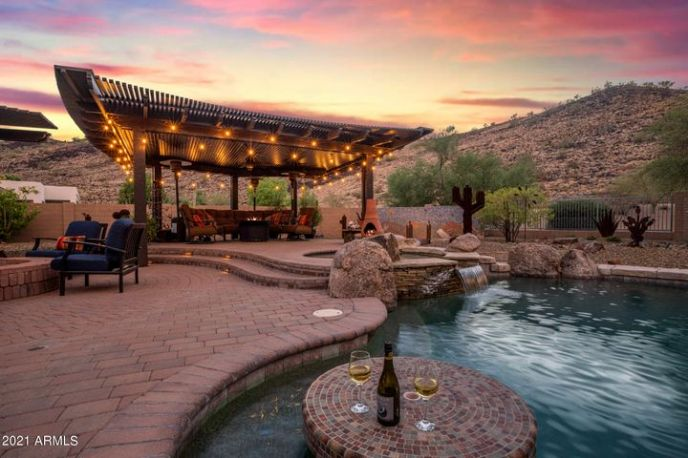 This backyard oasis has it all . . .views, privacy, outdoor living areas, pool, spa, fireplace, firepit and outdoor kitchen.
