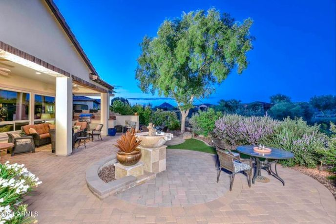 Resort Backyard with Extended Paver Patio, Synthetic Grass, Built-in BBQ Area with Pergola, and breathtaking Mountain, Golf, and Desert Views