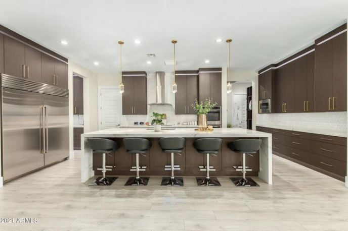 Enjoy the impressive kitchen featuring chic custom cabs with oversized eat-in island.