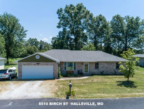 Extremely well maintained 3BR, 2B one level ranch with formal living room AND a family room! New in last year: High Efficiency HVAC (06/18), water heater (2019), water softener (2019), all windows except 2 front bedrooms (2019). Family room carpet to be replaced prior to closing. Laminate flooring in living, dining & kitchen. 2 car garage w/ pull down stairs to attic storage, parking for camper or boat next to garage. Fenced back yard w/ lawn storage shed. Hallsville Schools. 100% USDA financing available.