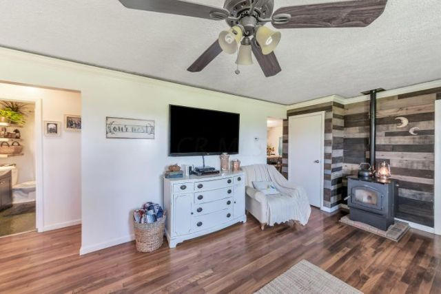 Great room features a beautiful accent wall done in shiplap.